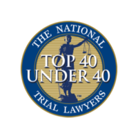 top 40 under 40 trial lawyers badge with blue outline, blue justice figure, and gold inside